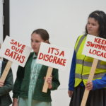 chidlren carrying protest banners for Stirchley baths